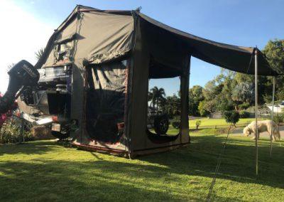 camper setup with boat still on trailer